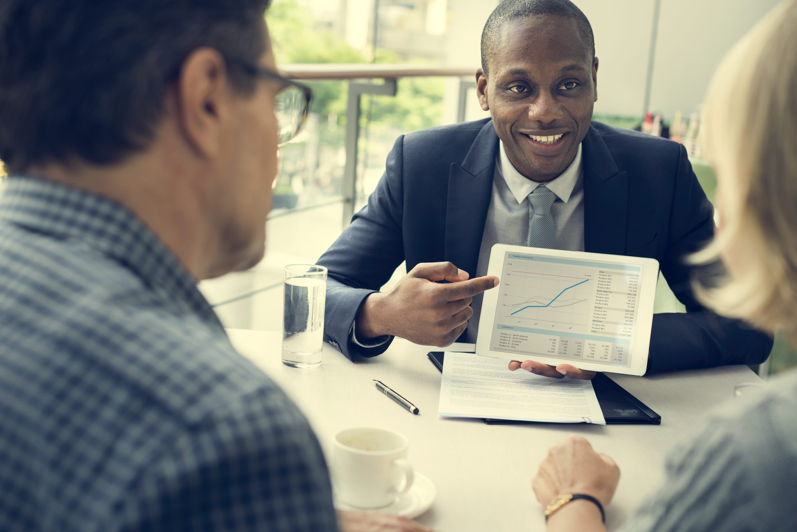 Investment advisor showing information and graphic to couple