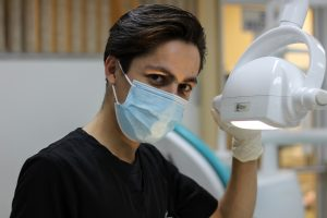 Dentist using medical equipment